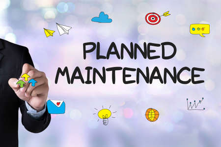 scheduled replacement: Planned Maintenance and Businessman drawing Landing Page on white background Stock Photo
