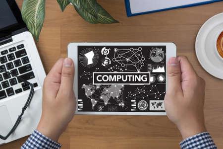 digital memory: COMPUTING (data Computer Digital Memory) man hand Tablet and coffee cup Stock Photo