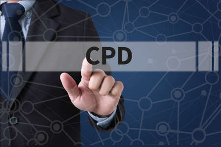 CPD  Continuing Professional Development Businessman hands touching on virtual screen and blurred city background Stock Photo - 60903724