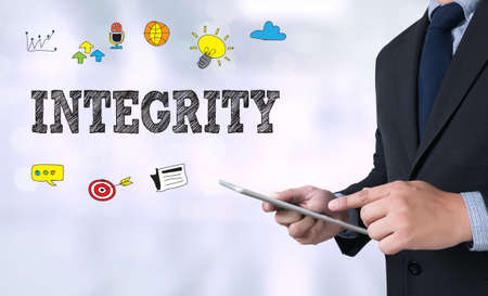 INTEGRITY   Ethics Loyalty Moral Motivation Businessman use a tablet computer