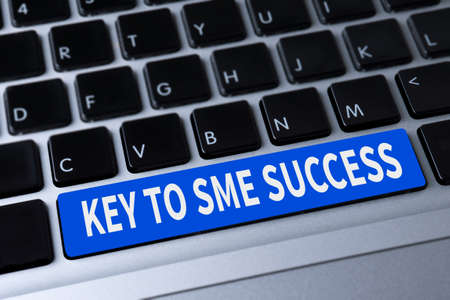 enterprises: KEY TO SME SUCCESS  Small and medium-sized enterprises a message on keyboard