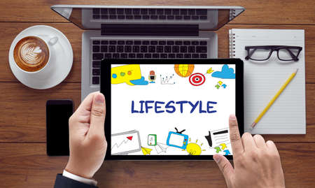situation: Lifestyle your Way of Life Habits Situation Culture up to you, on the tablet pc screen held by businessman hands - online, top view