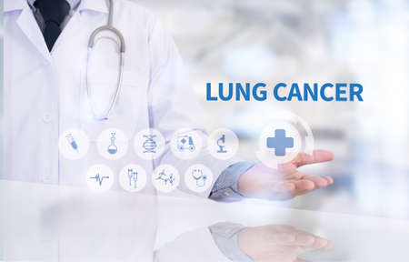 oncologist: LUNG CANCER Medicine doctor working with computer interface as medical Stock Photo