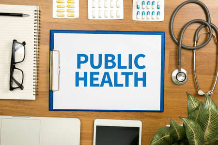 public health: PUBLIC HEALTH  Professional doctor use computer and medical equipment all around, desktop top view Stock Photo