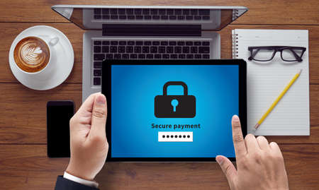 secure payment: Secure payment, on the tablet pc screen held by businessman hands - online, top view