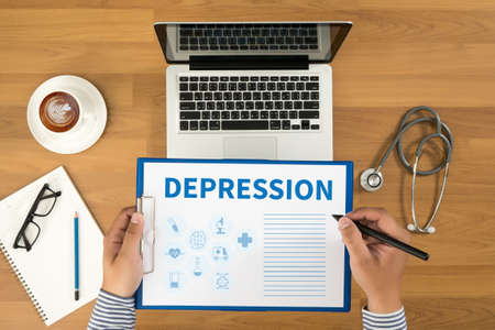major depression: DEPRESSION Doctor writing medical records on a clipboard, medical equipment and desktop on background, top view, coffee