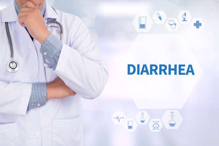 DIARRHEA Medicine doctor working with computer interface as medical Stock Photo