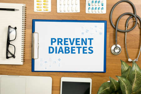 prevent: PREVENT DIABETES  Professional doctor use computer and medical equipment all around, desktop top view Stock Photo
