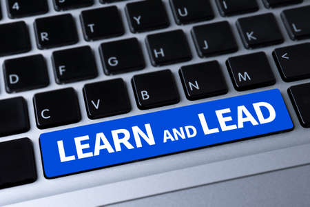 learn and lead: LEARN AND LEAD a message on keyboard