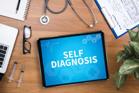 selfcontrol: SELF DIAGNOSIS Professional doctor use computer and medical equipment all around, desktop top view