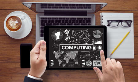 digital memory: COMPUTING (data Computer Digital Memory), on the tablet pc screen held by businessman hands - online, top view