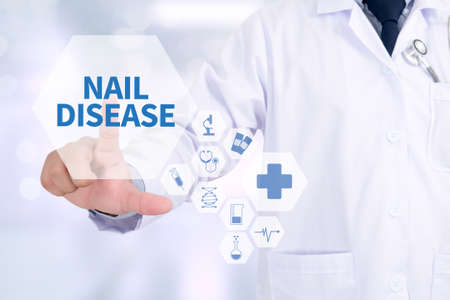 dystrophy: NAIL DISEASE Medicine doctor working with computer interface as medical Stock Photo