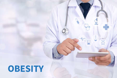 OBESITY Medicine doctor working with computer interface as medical Stock Photo