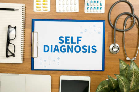 medicaid: SELF DIAGNOSIS Professional doctor use computer and medical equipment all around, desktop top view