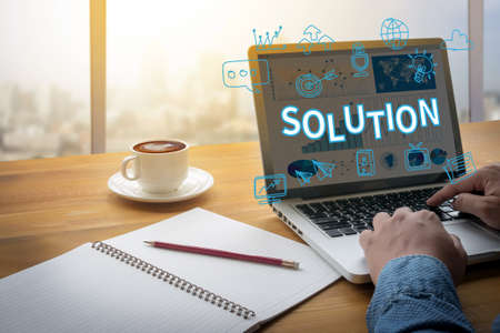 asian business meeting: SOLUTION ( Solution Innovation Progress Strategy Decision ) Computing Computer  flare sun, Cropped image male freelancer sitting at the table Stock Photo