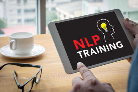 linguistic: NLP   Neuro Linguistic Programming Computing Computer  Laptop with screen on table Silhouette and filter sun Stock Photo