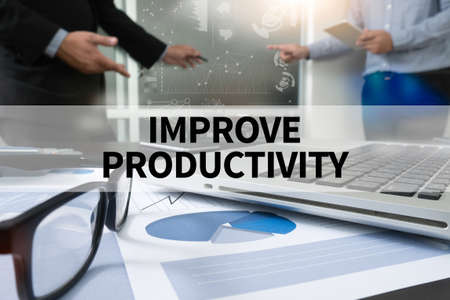 IMPROVE PRODUCTIVITY Businessman making presentation with his colleagues and business strategy digital layer effect at the office as concept Stock Photo