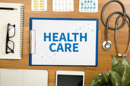 use computer: HEALTH CARE  Professional doctor use computer and medical equipment all around, desktop top view Stock Photo