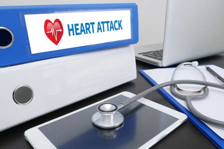 palpitations: HEART ATTACK Professional doctor use computer and medical equipment Stock Photo