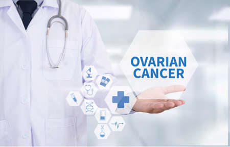ovarian: OVARIAN CANCER CONCEPT Medicine doctor hand working  Professional doctor use computer and medical equipment all around, desktop top view