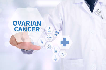 surgical removal: OVARIAN CANCER CONCEPT Medicine doctor working with computer interface as medical