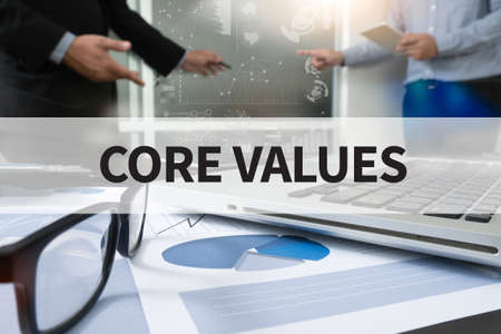 core strategy: CORE VALUES Businessman making presentation with his colleagues and business strategy digital layer effect at the office as concept Stock Photo