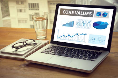 core strategy: CORE VALUES Computing Computer  Laptop with screen on table Silhouette and filter sun Stock Photo