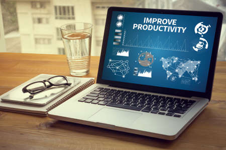 throughput: IMPROVE PRODUCTIVITY Computing Computer  Laptop with screen on table Silhouette and filter sun