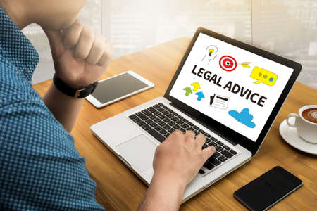 licensed: LEGAL ADVICE (Legal Advice Compliance Consulation Expertise Help) Computing Computer  flare sun, Cropped image male freelancer sitting at the table Silhouette and filter sun Stock Photo