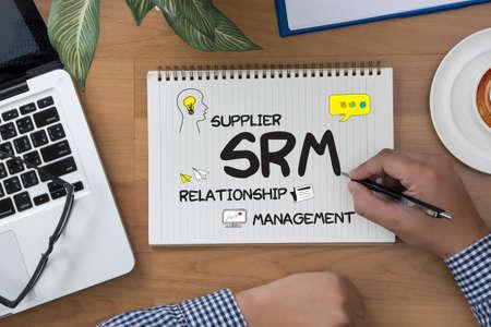 supplier: man work SRM Supplier Relationship Management  Assessment Enterprise Analysis  man hand notebook and other office equipment such as computer keyboard