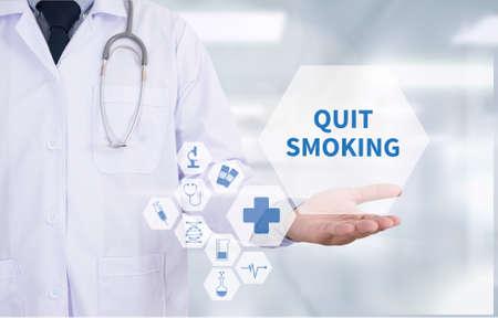 use computer: QUIT SMOKING Medicine doctor hand working  Professional doctor use computer and medical equipment all around, desktop top view