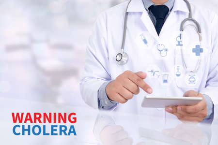 cholera: WARNING CHOLERA  Medicine doctor working with computer interface as medical Stock Photo