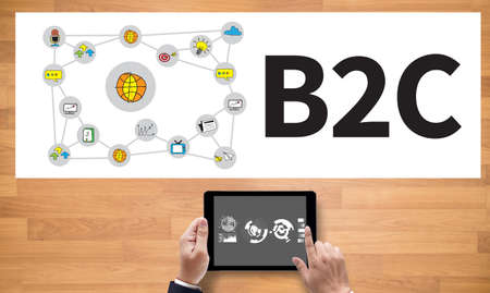 b2c: B2C  MARKETING    , on the tablet pc screen held by businessman hands - online, top view Stock Photo