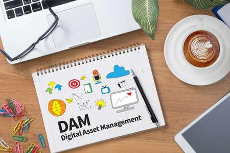 digital asset management: DAM Digital Asset Management Organization Tablet with blank black screen and coffee cup