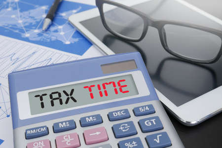 exemption: TAX TIME   Business team hands at work with financial reports Stock Photo