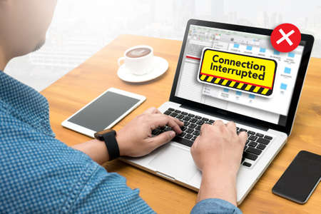 interrupted: computer Interrupted  Attention Alert Connection Interrupted Warning  Computing Computer  flare sun, Cropped image male freelancer sitting at the table Stock Photo