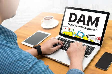 digital asset management: DAM Digital Asset Management Organization Computing Computer  flare sun, Cropped image male freelancer sitting at the table