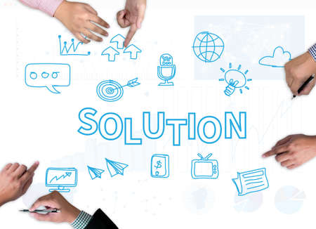 broad: SOLUTION ( Solution Innovation Progress Strategy Decision ) businessman work on white broad, top view Stock Photo