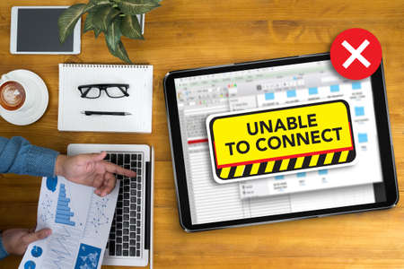unable: connect Unavailable Unable Connect Notification Businessman working at office desk and using computer and objects, coffee, top view,