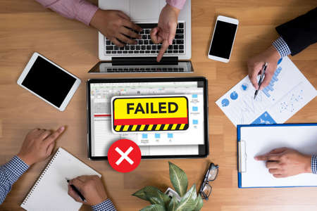 inability: NOT good Failed Fail Failing Fiasco Inability Unsuccessful it Failed Business team hands at work with financial reports and a laptop, top view Stock Photo