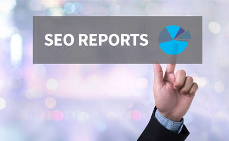 man pushing: SEO REPORTS man pushing (touching) virtual web browser address bar or search bar on blurred abstract background