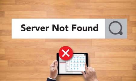 inaccessible: computer Server Not Found Error Inaccessible , on the tablet pc screen held by businessman hands - online, top view Stock Photo