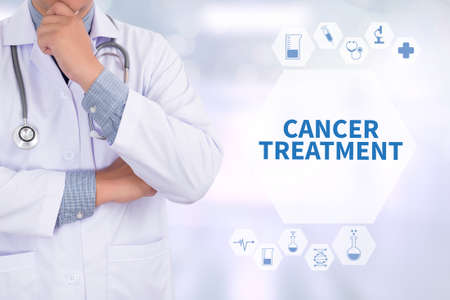 tumor stage: CANCER TREATMENT Medicine doctor working with computer interface as medical