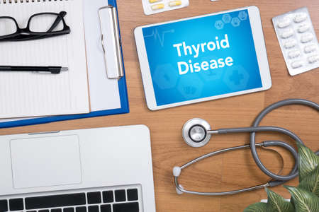 use computer: Thyroid Disease Professional doctor use computer and medical equipment all around, desktop top view