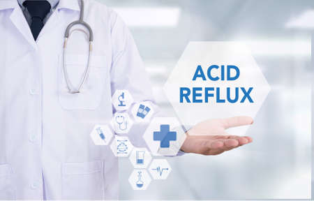 gastroenterology: ACID REFLUX Medicine doctor hand working  Professional doctor use computer and medical equipment all around, desktop top view Stock Photo