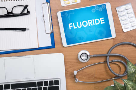 fluoride: FLUORIDE Professional doctor use computer and medical equipment all around, desktop top view
