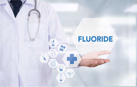 fluorine: FLUORIDE Medicine doctor hand working  Professional doctor use computer and medical equipment all around, desktop top view