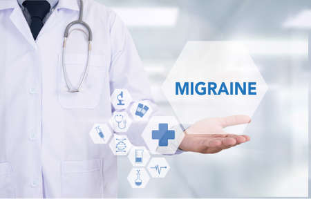 megrim: MIGRAINE Medicine doctor hand working  Professional doctor use computer and medical equipment all around, desktop top view