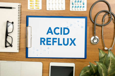 acid reflux: ACID REFLUX Professional doctor use computer and medical equipment all around, desktop top view