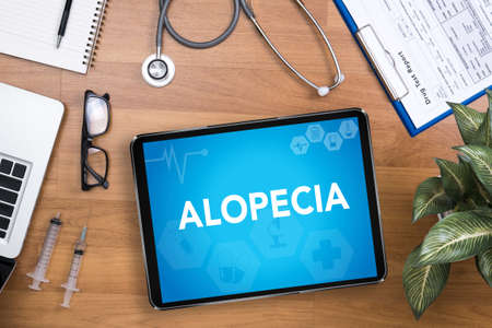 case history: ALOPECIA Professional doctor use computer and medical equipment all around, desktop top view Stock Photo